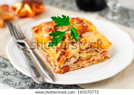 A Piece of Chicken and Pumpkin Lasagna, Christmas Dinner, shallow dof - stock photo