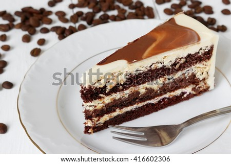 a piece of chocolate cake with cream; shallow depth of field