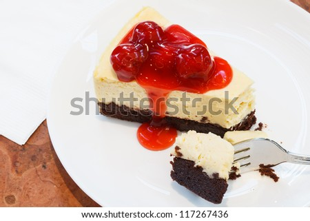 A piece of Cut Cheese Cake is on a disc - stock photo