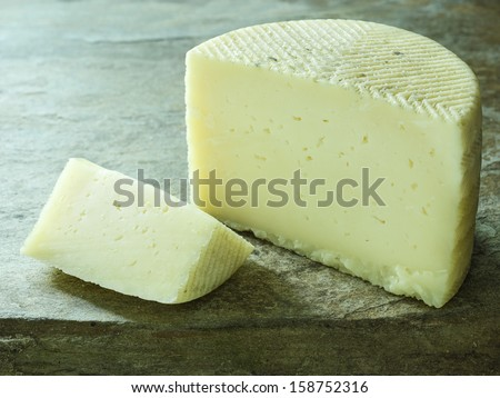 a piece of delicious machego spanish cheese - stock photo