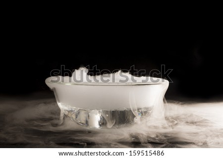 A piece of dry ice dropped into the water. Listed effect boiling of water caused by the transition from a solid state to a gaseous ice