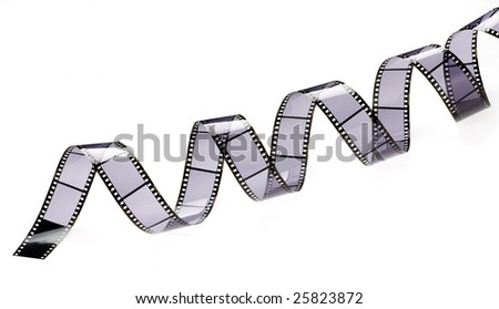 a piece of film rolled on a white background - stock photo