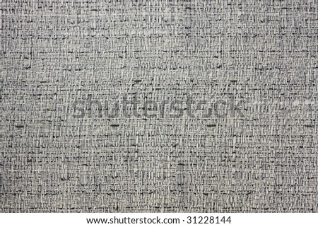 a piece of hessian like contemporary fabric with grey, black and white color. - stock photo