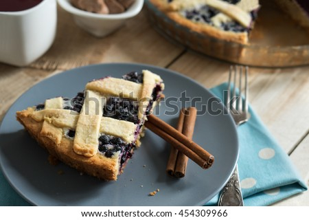 A piece of homemade blueberry pie with a crispy crust. Close-up. - stock photo