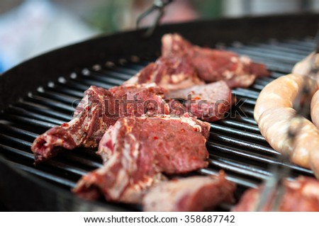 A piece of meat on barbecues