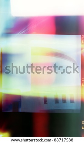A piece of medium format film with colorful abstract filling in frame, good for background - stock photo