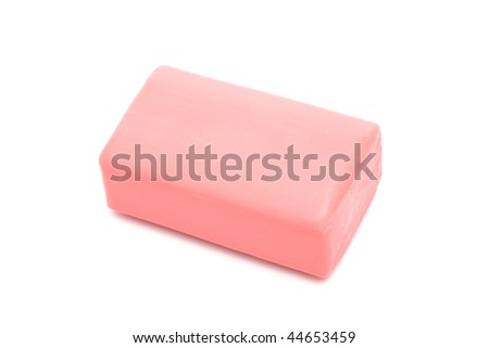 a piece of pink soap on a white background