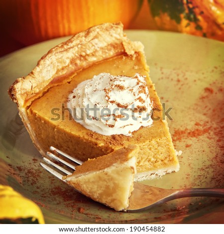 A piece of pumpkin pie on a green plate, instagram filter style - stock photo
