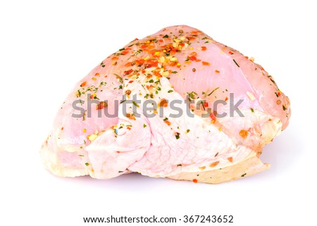 A Piece of Raw Turkey in Spices for Grilling Isolated on White Background - stock photo