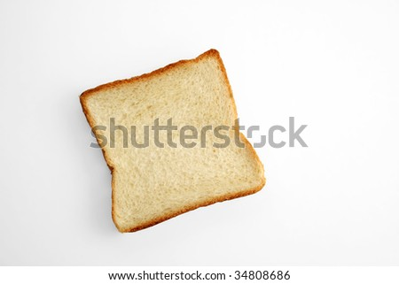 a piece of toast bread on a white table - stock photo