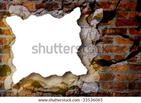 A piece of torn, white paper with rough edges is on a grunge background. The background has a variety of textures and surfaces.
