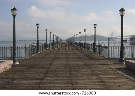 A pier extends into San Francisco's waterfront.