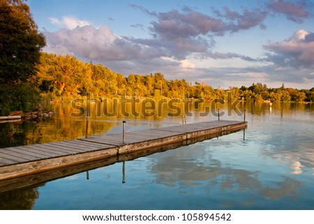 A pier in a beautiful lake in Ontario - stock photo