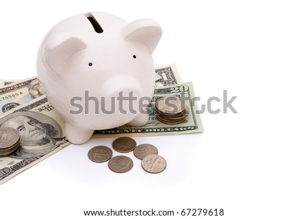A piggy bank with money isolated on a white background, savings - stock photo