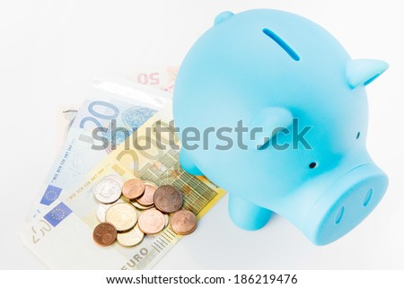 A piggy bank with money on white background, savings