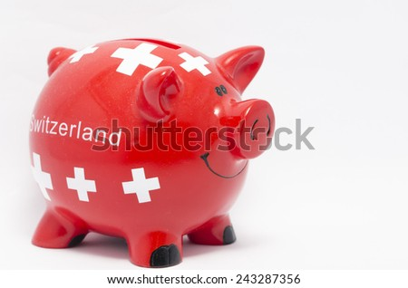 A piggy bank with Switzerland flag on the white background  - stock photo