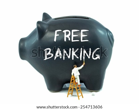 A piggy bank with the words free banking painted on the side on a white background - stock photo