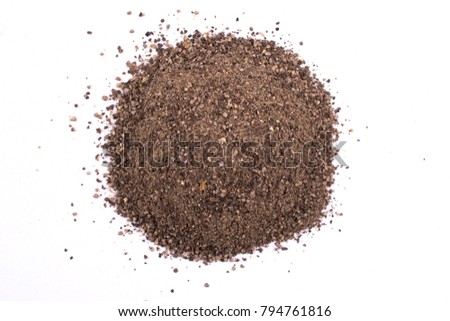 A pile of a  dry black pepper powder isolated on white background