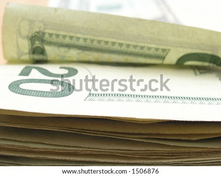 A pile of American $20 bills. - stock photo