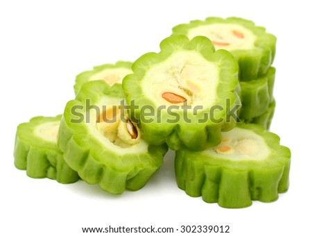 A pile of bitter melon on chopping - stock photo