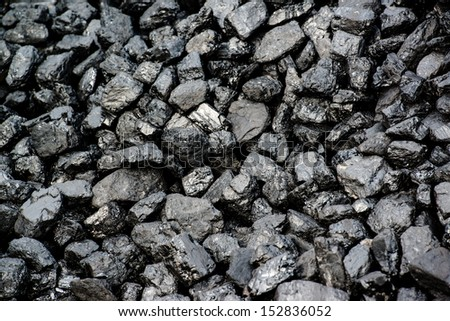 A pile of black coal from mining pit - background - stock photo