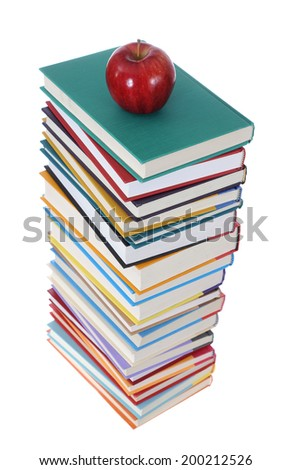 a pile of books and apple isolated on white background - stock photo