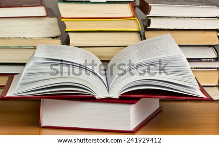 A pile of books with library on the back. background - stock photo