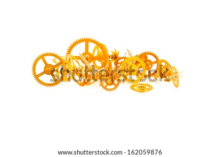 a pile of bracket clock gear isolated on white background - stock photo