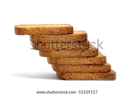 a pile of bread rusks isolated on a white background - stock photo