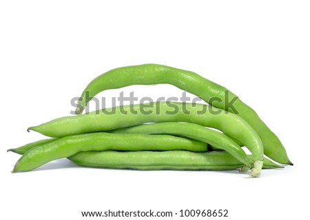 a pile of broad bean pods with the beans inside on a white background - stock photo
