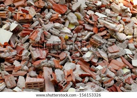A pile of broken bricks - stock photo