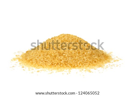 a pile of brown granulated sugar on a white background - stock photo