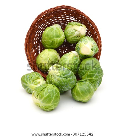 a pile of Brussels sprouts in basket on a white background