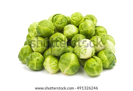 a pile of Brussels sprouts on a white background