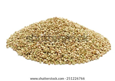 a pile of buckwheat seeds on a white background