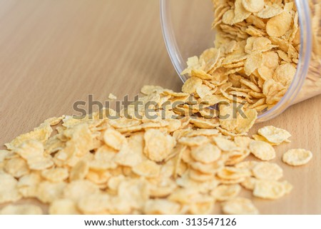 A pile of cereal on wood table (soft focus) - stock photo
