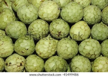 a pile of cherimoyas in a vegetables market - stock photo