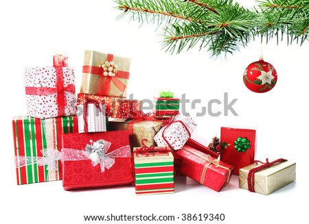 A pile of Christmas gifts in colorful wrapping with ribbons under a Christmas tree.. - stock photo