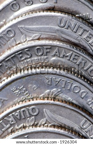 A pile of coins up close - stock photo