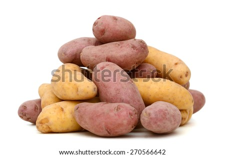 a pile of colored potatoes on white background  - stock photo
