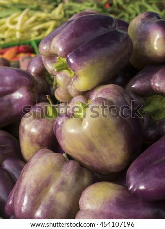 A pile of colorful bell peppers at local farm market. - stock photo