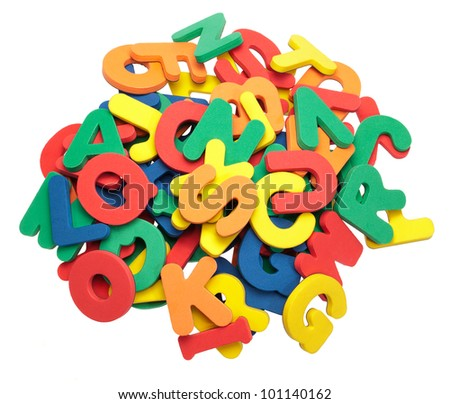A pile of colorful foam letters. - stock photo