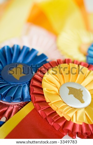 A pile of colorful ribbons won at horse shows. - stock photo