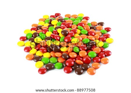 a pile of colourful candies in white background - stock photo