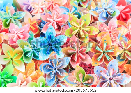 A pile of colourful Japanese Kusudama flower pieces - stock photo