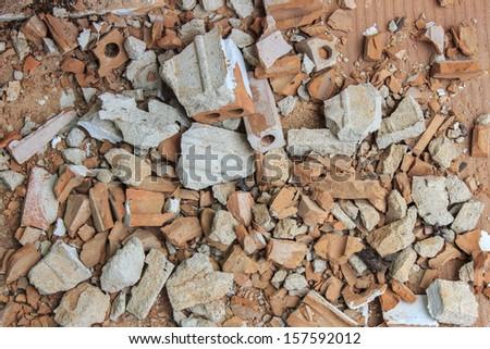 A pile of debris, broken pieces of brick - stock photo