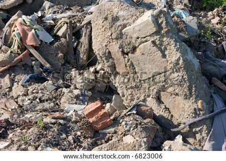 A pile of debris of a destroyed building - stock photo