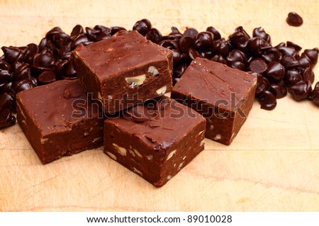pile of delicious fresh baked pieces of chocolate fudge on a wooden ...
