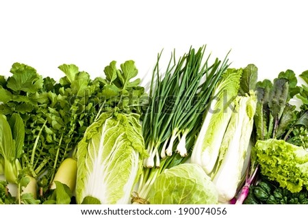 A pile of different types of leafy green vegetables. - stock photo
