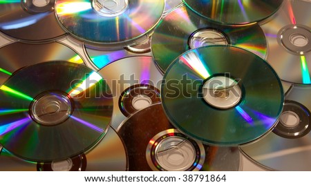 A pile of dirty compact discs - stock photo